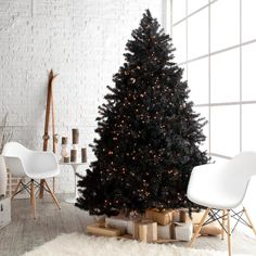 Add a contemporary twist to your traditional décor with this gorgeous black prelit Christmas tree.