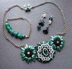 Spring Noir set by by Windbent. Beading by Klaudete Koon. Hand painted and constructed with: vintage copper, copper-plate and silver-tone metals; Victorian glass buttons; Czech glass beads; lamp-work from Kokomo Opalescent Glass; pewter; Chinese crystals; and resin/shell beads.