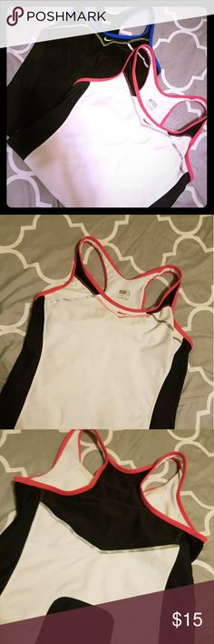 2 Nike Dri Fit workout tops 2 Nike Dri Fit with built in bra for support.  Tops great for the gym, pair with a cute pair of running shoes from my closet. I discount bundles! Nike Tops Tank Tops