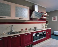 Idea of the Day: A modern two-tone kitchen with highly textured red cabinets and a striped backsplash. By Latini Cucine. Lovely, two tone red textured wood beverli glass hood Design Your Kitchen, Best Kitchen Designs, Red Kitchen Cabinets, Kitchen Triangle, Kitchen Cabinet Manufacturers, Two Tone Kitchen, Functional Kitchen, Kitchen Storage, A Table