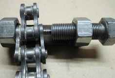 Motorcycle Chain Breaker Homemade motorcycle chain breaker fashioned by welding nuts to a steel bar and inserting a bolt to facilitate chain repair