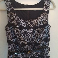 Beautiful Dress NWT Black dress with beautiful silver flower design all over.  Falls above the knees and comes with a small black belt. Size Small. Pretty dress! BeBop Dresses Midi