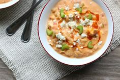 Slow Cooker Buffalo Chicken Chili--a creamy white bean chicken chili that is flavored with buffalo sauce and fire roasted tomatoes. It's basically the soup version of buffalo chicken dip.