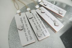 "Little Quote Tags Add this to a gift or round a bottle of wine or just in a card as a little cute gift, making a lovely keepsake for that special personIdeal for lots off occasions i.e., Birthday, Wedding, Anniversary or Christmas etc This little tag measures 75mm x 25mm Hung with natural twine and white wooden beadAdded white hearts compliment the finished look on each design Just click on the "" quote"" you wish to buy in the options on the listing"