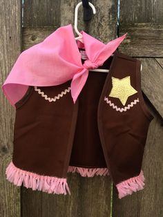 Brown twill fabric/appliqued gold star, pink sparkly ric-rac & fringe, and pink neck scarf. Also available in adult sizes  Check it out! PARTY PACKS!! at https://www.etsy.com/listing/287956349 Felt vests with star and ric-rac trim. Sold in packs of 5 or 8. Perfect for your Sheriff Callie party!  Check out the Callie dress in my shop!  HALLOWEEN -Orders placed in September will take 2 -3 weeks to ship. Last year, no orders were accepted after September 25th because of the huge volume! DONT BE…