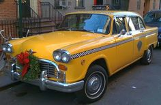 Vintage NYC Yellow Checker Cab (Front View) --- A Christmas wreath decorates the grille!