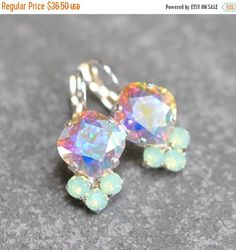 ❘❘❙❙❚❚ ON SALE ❚❚❙❙❘❘     → Our LOLITA Rhinestone Tennis Leverback Dangle Earrings ←  Lolita Drops - Swarovski Crystal Rhinestone Dangle Earrings ● Color: Aurora Borealis Pastel Rainbow with a Moonlight or Clear Diamond Rhinestone Cluster ● Size Approximately: 30mm long or a little under 1.5 ● Metal: Antique Brass, Silver Plate, Gold Plate, Black Oxidized   Earrings Are Nickel Free  ❥❥ These Sparklers will come packaged in a velvet pouch, boxed and bowed to perfection. Ready to give as a…