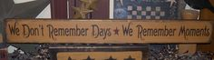 WE REMEMBER MOMENTS PRIMITIVE SIGNS SIGN