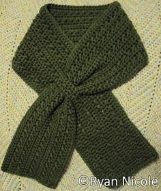 "A very textured keyhole scarf using only 2 stitches. It is approximately 44"" long and 5"" wide. It is worked side to side, so you start with the length of the scarf. It can easily be lengthened or shortened, by changing the starting chain number. $2.50 on Ravelry.com ."