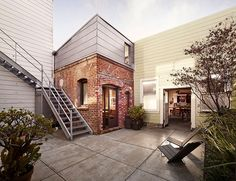 Tiny & modern brick guesthouse was once a laundry boiler room