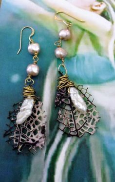 Hey, I found this really awesome Etsy listing at http://www.etsy.com/listing/153845804/beautiful-mermaid-sea-fan-earrings-with