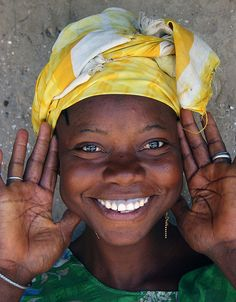 Fulani girl in Tabakoto, a small village in The Gambia. I met her just outside her very modest home. She is another example of the many smiles that you will encounter all over Africa. Despite the very little that most people posess you will always get a great happy smile.