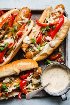 Juicy Italian sausages and peppers are roasted together on a sheet pan—yay for easy clean up—and stuffed into classic hoagie rolls for an Italian sausage sandwich that's delicious anytime of day. Sausage Sandwich Recipes, Sausage And Peppers Sandwich, Italian Sausage Sandwich, Italian Sausages, Hoagie Sandwiches, Sausage Sandwiches, Dinner Sandwiches, Best Sausage, Grilled Sausage