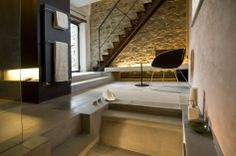 Architecture, Bathroom Modern Rustic Mountain Hotel Design With Stone Wall Ideas And Wall Mounted Towel Bar: The Stunning Contemporary Bouti...
