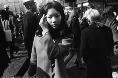 Scenes from the streets: Asian Girl with Hand to Hair, NYC, 1968