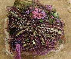 Embroidered cuffs, like the purple and green and pink together, and the use of glass and different textures