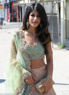 Show-stopper: The Essex girl slipped her svelte figure into a pink A-line maxi skirt, whic...