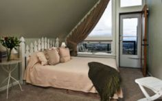 The Rose Garden Room has a vaulted ceiling over the queen-size bed.  It has a private, attached bathroom with claw foot tub and separate shower and a private deck with valley views.