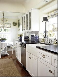 White Country Galley Kitchen stylish home: colourful kitchen inspiration | dark ceiling, white