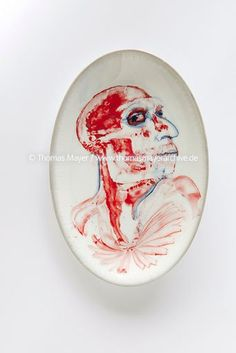 Hans Lemmen drawing on porcelain
