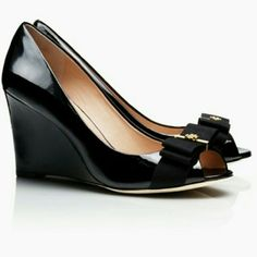 Tory Burch Wedges Tory Burch Trudy Open Toe Wedge size 8.5. Comes with the box. Black patent leather with bow and gold logo. Very comfortable. Shoe looks new, despite the soles being worn. Purchase at Tory Store for $430 Tory Burch Shoes Wedges