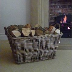 large log basket by marquis & dawe | notonthehighstreet.com Imagine in winter, the fire burning, and this lovely basket beside the fire.