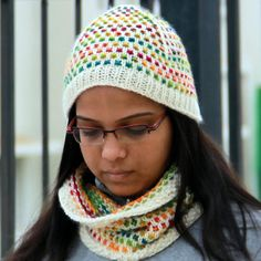 Punto hat uses a simple stitch pattern wherein the contrast colored yarn stands out as dots (or Punto in Spanish) against the main colored yarn. Use variegated yarn to get a colorful look without fiddling with too many yarns or choose a solid or semi-solid yarn as your contrast yarn for a less funky look.