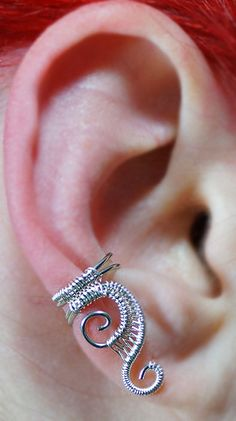 Woven Swirly Silver Ear Cuff. $8.00, via Etsy.