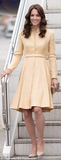 Kate arriving at Paro International Airport in a yellow coat dress...