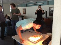 Our MD blows. out the candles on our birthday cake, May