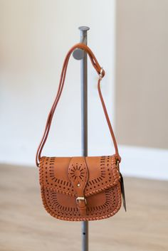 Later cut purse with buckle front and adjustable strap!  This bag is the perfect size!