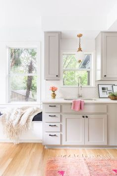10 kitchen design ideas for a warmer kitchen. We're loving these cabinet colors, statement lights, warm rugs, rustic styling details and pretty hardware. Take a peek! Built In Cabinets, Grey Cabinets, Kitchen Cabinets, Rustic Cabinets, Kitchen Sink, New Kitchen, Kitchen Decor, Kitchen Rustic, Boho Home