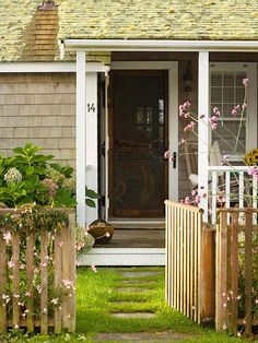 Door Duo - A double layer of doors offers options when the weather warms up or cools off. Here, a white, barn-style door opens to reveal a screen door -- all the better to admit air, the fragrance of flowers from the garden, and birdsongs.