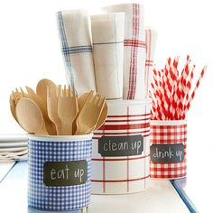 Decorative Utensil Jars ~Don't bother setting the table -- guests can grab what they need from these adorable, no-fuss utensil jars. Simply decorate containters, like empty oatmeal canisters, by wrapping them with festive paper and securing with tape. Add an adhesive chalkboard label to send a fun message.