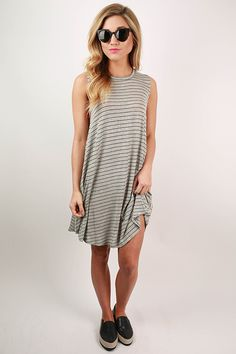 Meet your date on the boardwalk in this striped cutie! We love this dress paired with sunnies and cute sneakers for an adorable casual look!