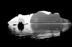Kayaking near through a cave in Halong Bay, Vietnam - Photo taken by BradJIll