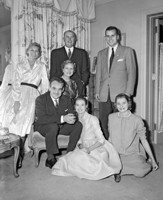 "Engagement photo at the Kelly family home in Philadelphia with Grace's older sister Peggy Kelly Davis, father John B. ""Jack"" Kelly, brother John B. ""Kell"" Kelly Jr., mother Margaret Kelly, Prince Rainier III of Monaco, Grace, and younger sister Lizanne Kelly Levine."