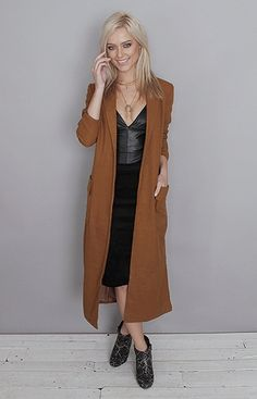 This long coat (€97) is a Folkster staff favorite, we all have one. Its so flattering on and perfect for everyday wear, looks great and will keep you warm in this cold weather. It comes in two colors: mustard and black.   Grace is a size UK 8 and is wearing a small. Length: apx 115 cm Width across shoulders: 34 cm (small) Model Height: 5ft 8  Material: 35% Cotton 65% Polyester  Care: Hand Wash Only- Cold  From L.A. Cold Weather, Mustard, Looks Great, Ireland, Style Me, Duster Coat, Stylists, Warm, Colors