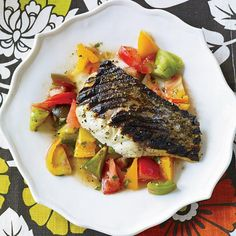 Grilled Striped Bass with Indian-Spiced Tomato Salad   Chef Floyd Cardoz is an avid fisherman. A favorite seafood dish is this summery grilled bass with ginger-spiced tomato salad.