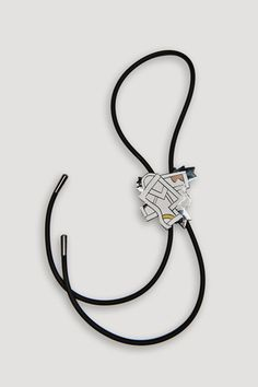 "Artist/Designer: Ettore Sottsass b. 1917 - 2007 Innsbruck, Austria Title: Futura Bolo Tie Medium: Handmade cloisonné, rubber cord with metal tips Dimensions: 2.63""h x 2.5"" with 35.5"" rubber cord with"