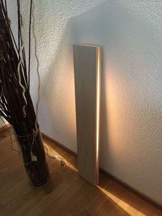 Glowing wood decoration using LED lights between wood.