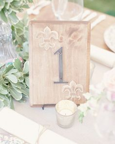 Jennifer's parents made table numbers for her reception using house numbers and stained wooden blocks from the local hardware store.