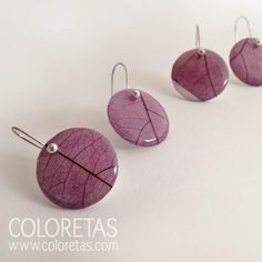 """Purple Ivy earrings with sterling silver hook (925). Real Ivy skeleton leaves that float on a white base creating original and colorful effects. """"Hedera"""". Since past times we are associated with immortality and the cycle of life and rebirth. Our particular heart shape represents love and loyalty for the way in which we intertwine among us."""