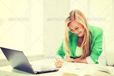 smiling student girl writing in notebook ...  attractive, books, campus, caucasian, classroom, college, color, communication, computer, distance, e-learning, education, european, exam, female, friendly, girl, happy, home, internet, laptop, learning, making, modern, networking, new, nice, notebook, notes, online, pc, people, preparing, scholar, school, smiling, social, student, studying, taking, technology, teen, teenager, university, woman, work, working, writing, young