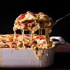 Fresh sheets of pasta are layered with a hot Italian sausage ragù, pesto ricotta and two pounds of mozzarella for the ultimate lasagna.