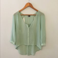 Urban Outfitters Mint Blouse Beautiful, flowing mint-colored blouse by Sparkle & Fade from Urban Outfitters. Unique cutouts in the back. There's a bit of pulling on the fabric on the right side (pictured) but when worn it's barely noticeable. Urban Outfitters Tops Blouses