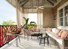 The veranda is furnished with a vintage French rattan chair and an RH sectional sofa and curtains; the low tables are by IKEA. Tour Alessandra Branca's Vacation Home in the Bahamas Photos Architectural Digest, Outdoor Rooms, Outdoor Living, Outdoor Furniture Sets, Outdoor Decor, Outdoor Couch, Outdoor Retreat, Bahamas House, Bahamas Vacation