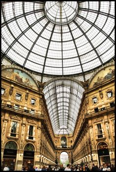 Milan ~ Italy ~ Galleria Vittorio Emanuele II  ~  Galleria Vittorio Emanuele II shopping mall, which links Piazza del Duomo with the Teatro alla Scala, is the most elegant and stylish shopping mall in Milan. Lined with cafes, restaurants and shops, its octagonal shape is adorned with mosaics and a magnificent glass roof.