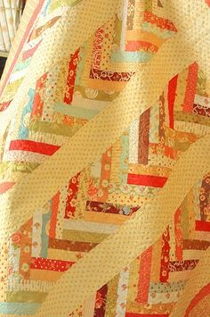 figtree quilts, by ashleyw...I've made this in a clas and it was called Flying Geese.  Then in other places a similar pattern was called Braids.  A great way to use scraps!