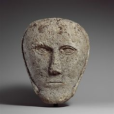 Celtic Limestone Head of a Man wearing a cap or helmet c.2nd/3rd Century BC British Height: 24.1 cm